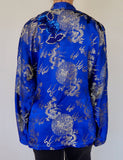 Vintage women's traditional Chinese top adorned by Jen Wonders