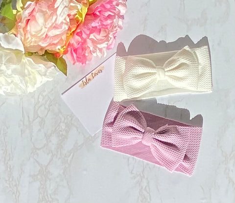 White and purple headbands with bows