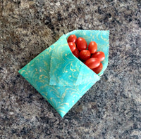 Grape tomatoes enveloped in a big blue beeswax wrap