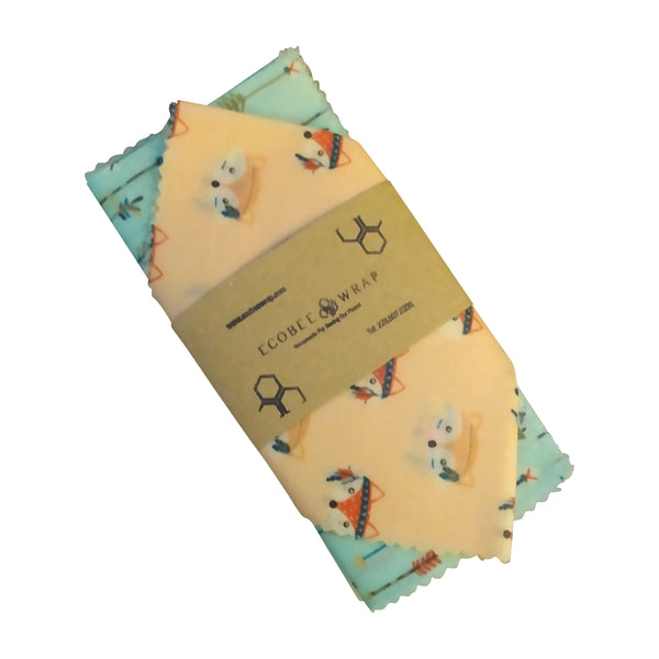 Outdoor patterned beeswax wrap folded in an eco-friendly package sleeve