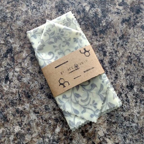 Four pack wisteria patterned beeswax wrap folded in an eco-friendly package sleeve