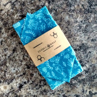 Blue early birds patterned beeswax wrap in eco-friendly packaging