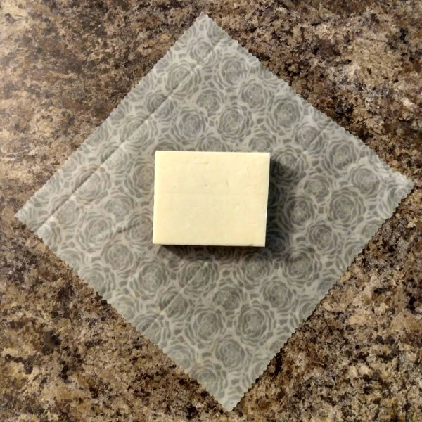 Piece of cheese centered on a medium-sized beeswax wrap