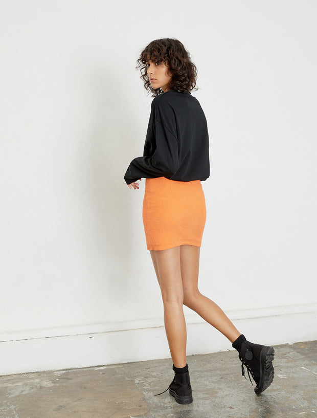 women's orange knitted mini skirt back