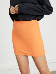 women's orange knitted mini skirt close