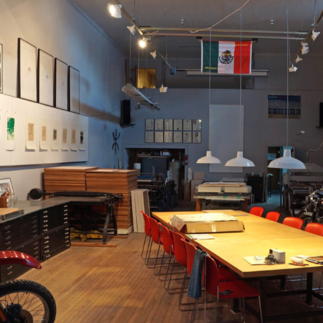 Vintage motorcycles, prints, and a Mexican flag adorn the interior of Arber & Son.