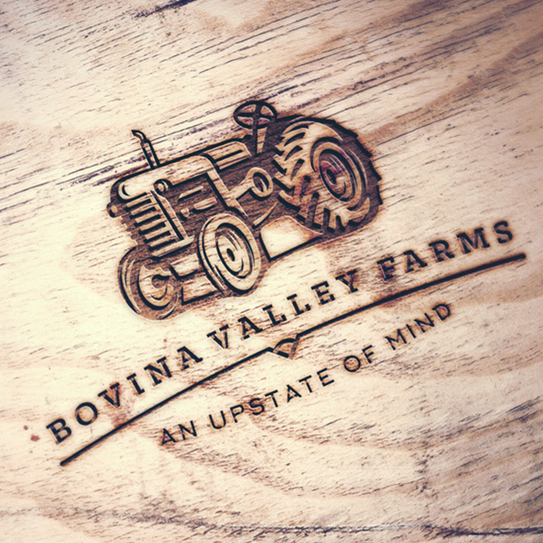 Bovina Valley Farms logo with tractor on a wooden board.