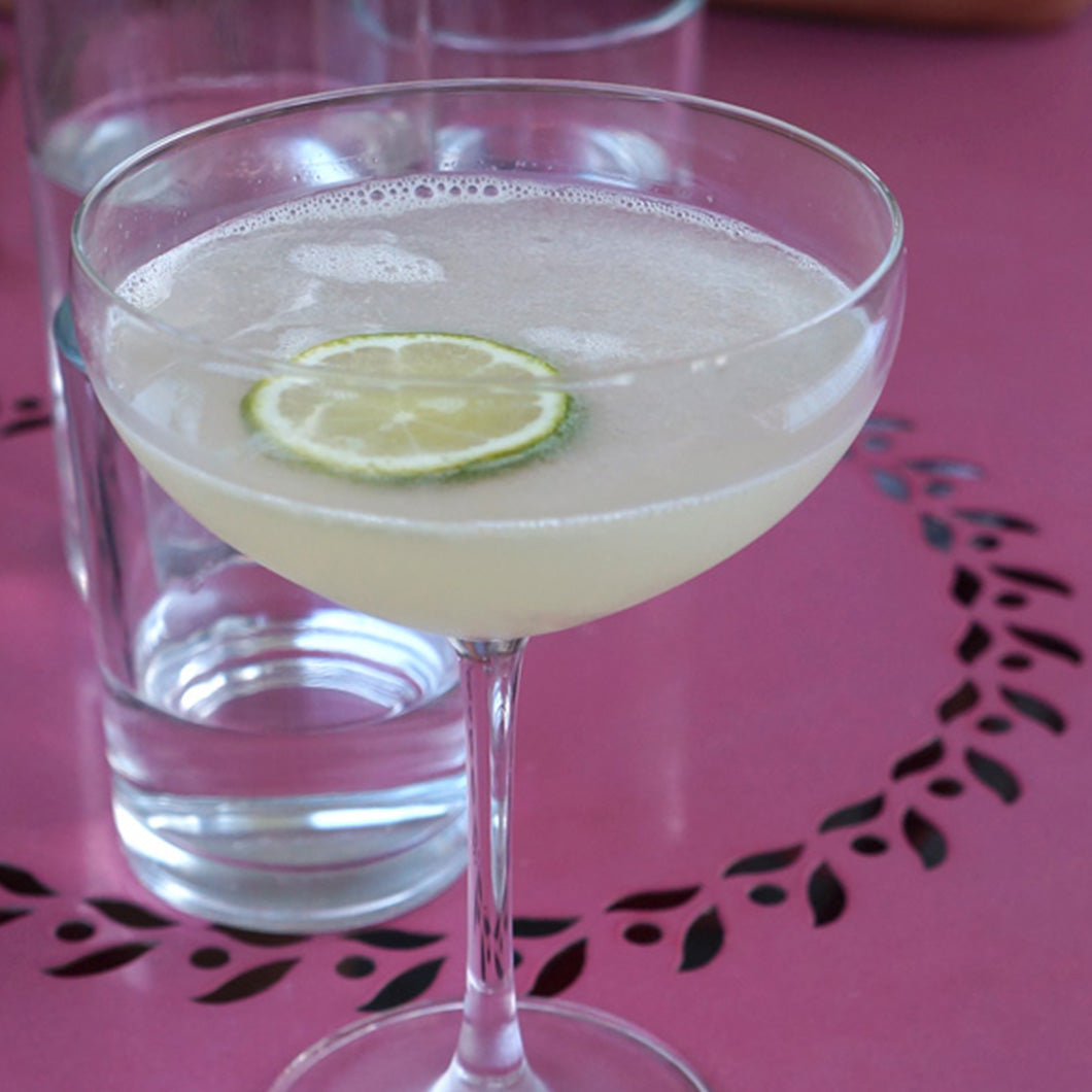 Tequila Gimlet from Cochineal on a pink table.