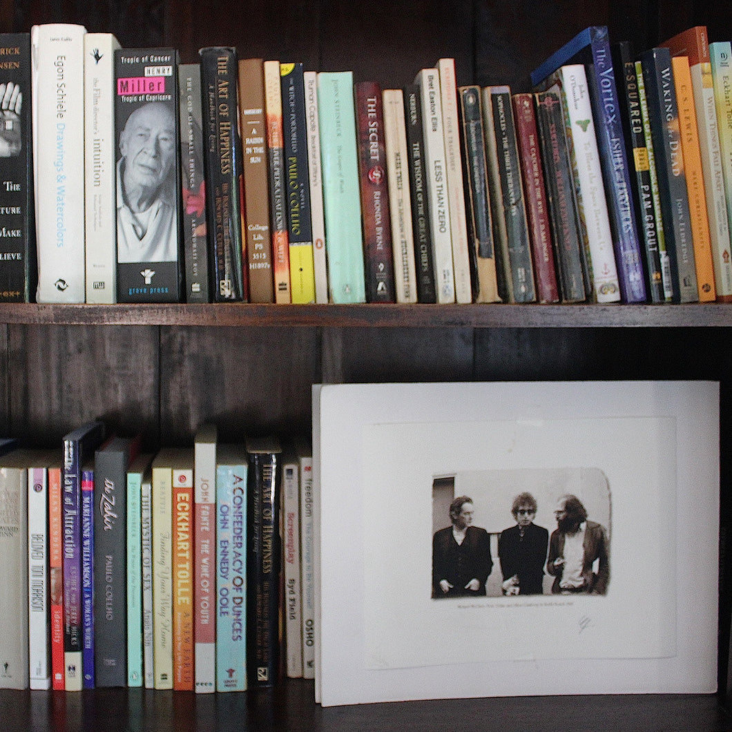 Bookshelves filled with books and photograph.