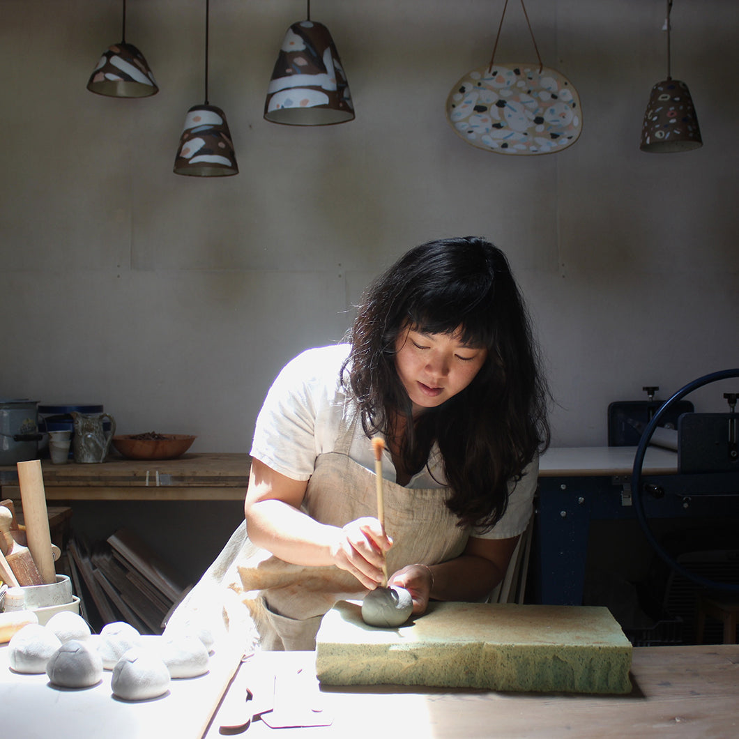 Linda working on a clay piece in her studio.