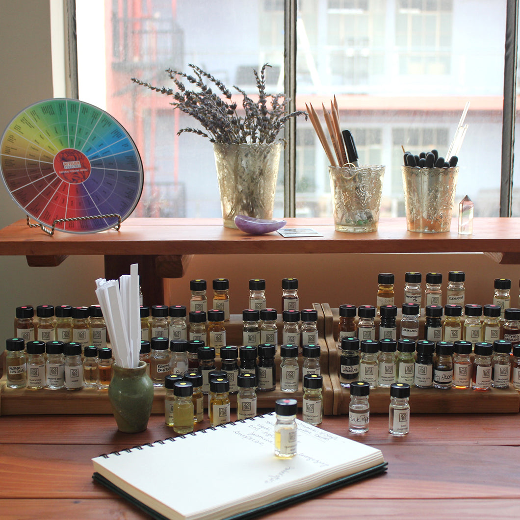Krystal's natural perfume color wheel and collection of oils.