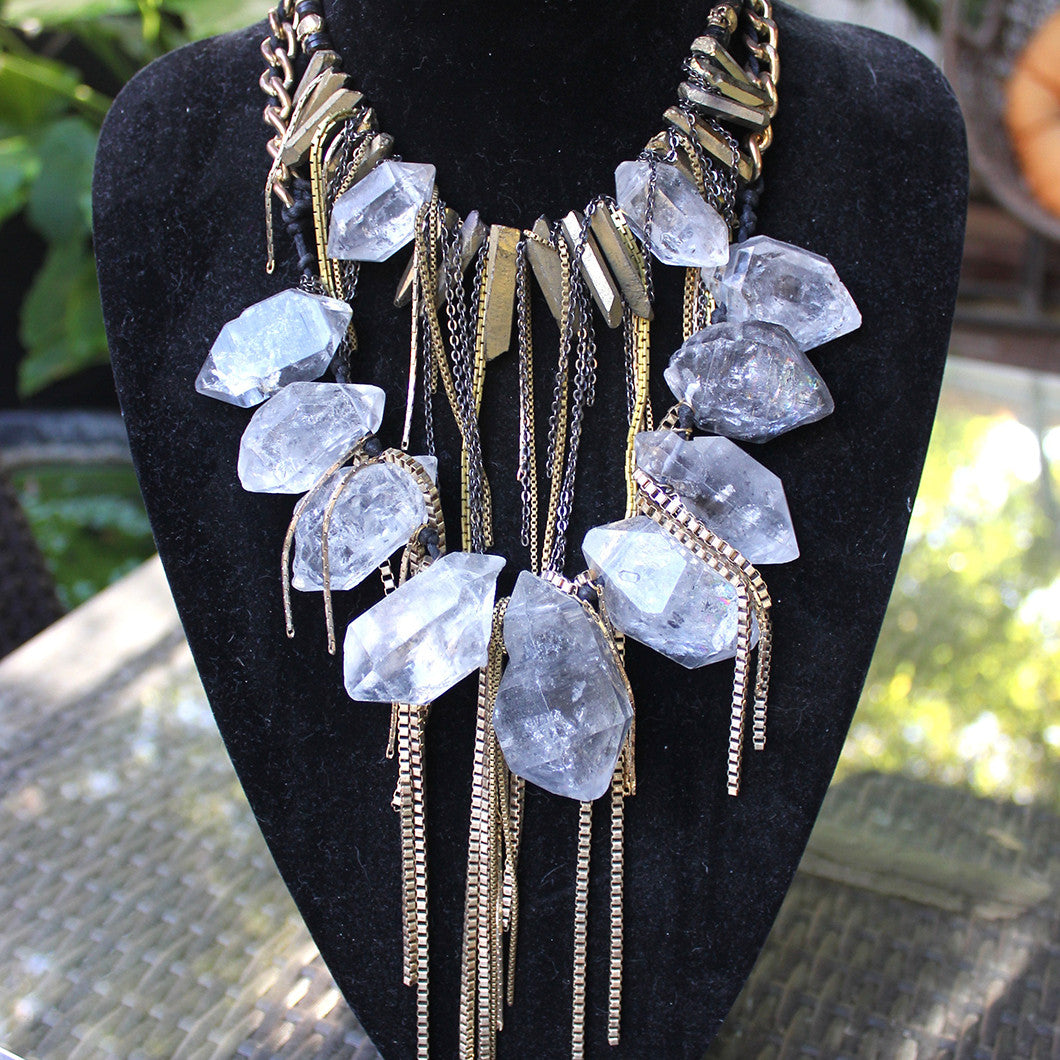 Necklace of gold fringe and big, bold crystals.