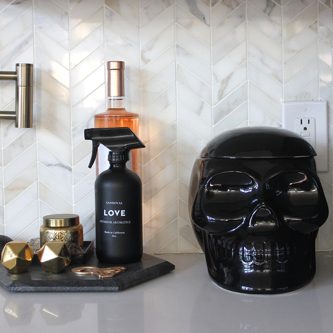 A large, black stone skull sits on one of Rosa's countertops.