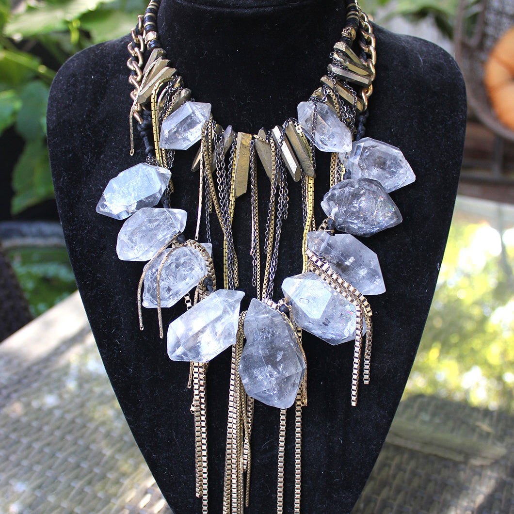 One of Rosa's crystal neckalces with gold metal fringe.