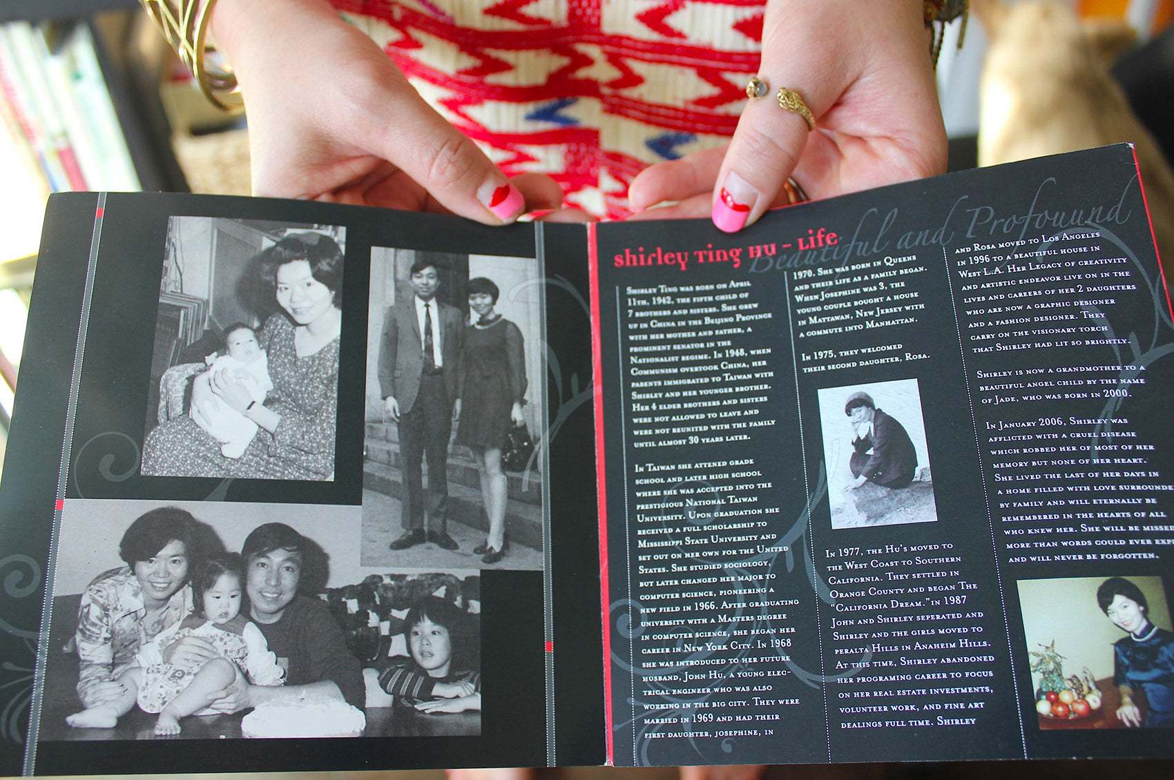 Rosa displays a magazine article featuring her mother, Shirley Ting Hu.