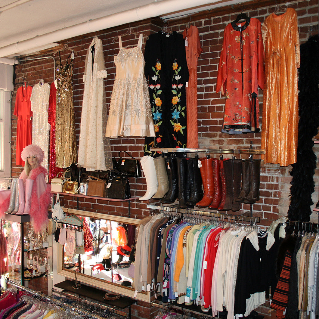 Colorful, vintage boots, hats, and dresses adorn the walls of Hattie's.