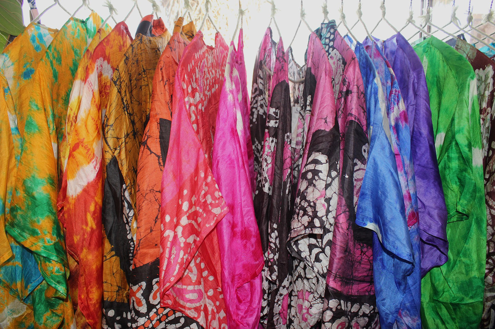 Rack of colorful dresses.