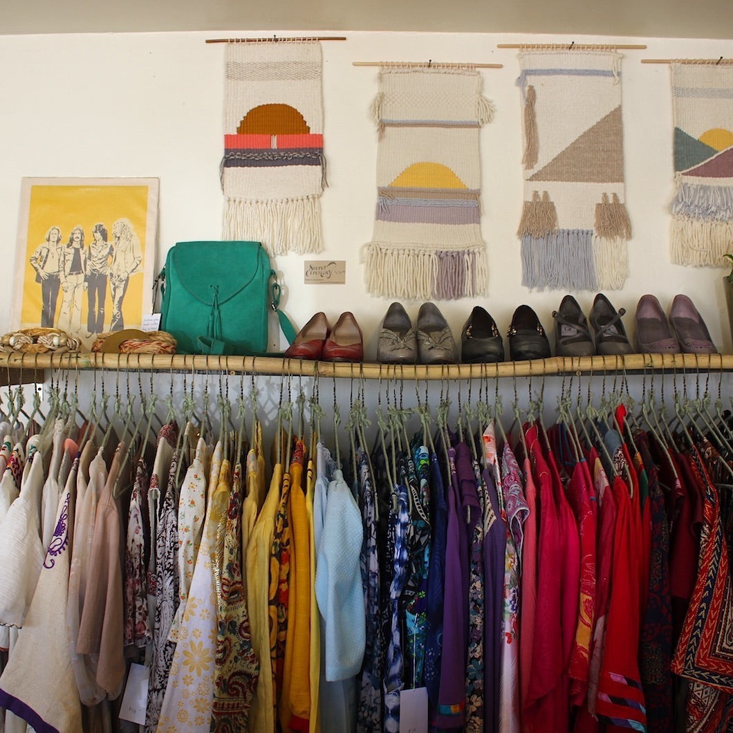 Decorated wall and clothing rack.