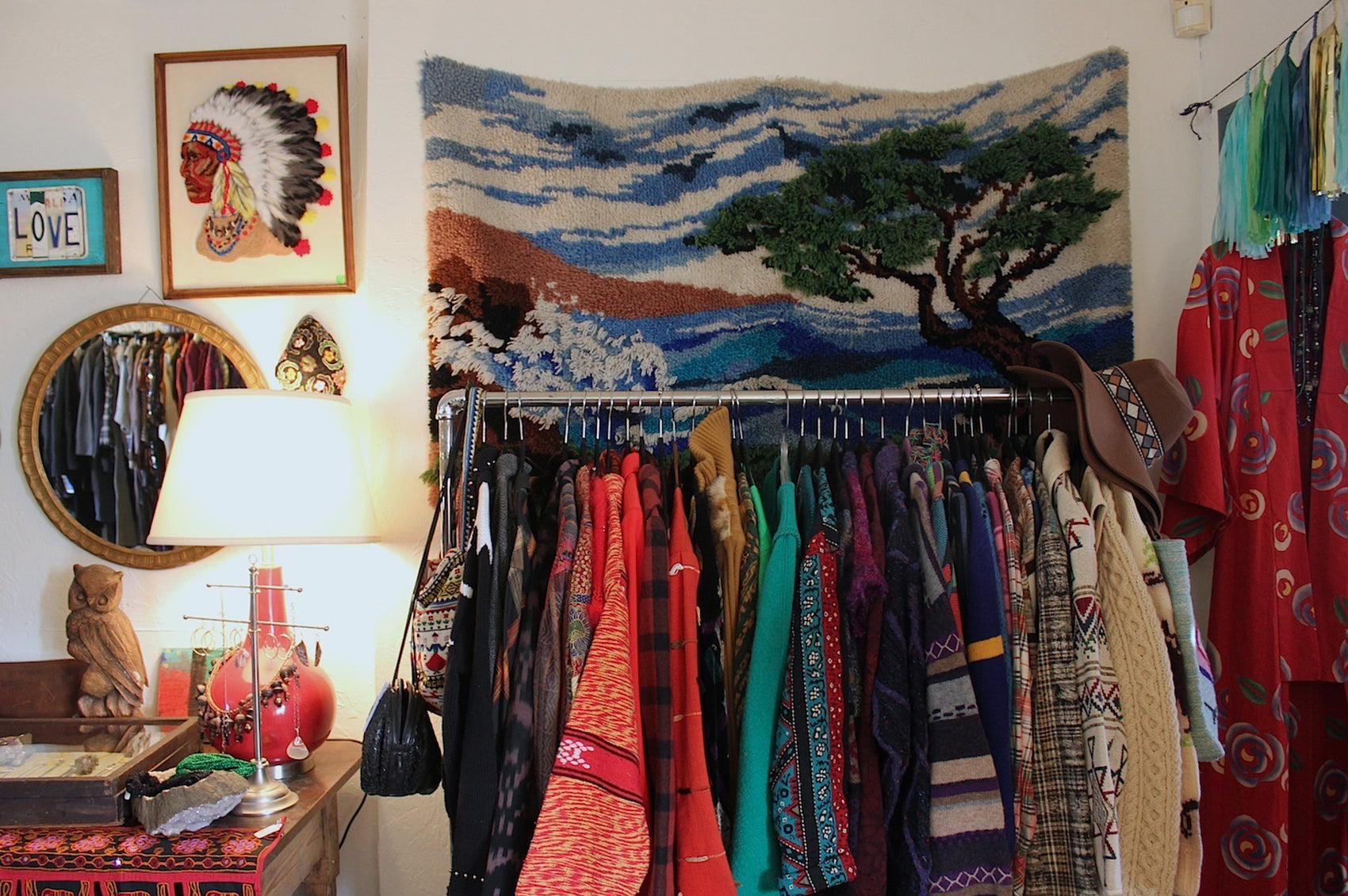 Rack of clothes and decorated wall in The End shop.