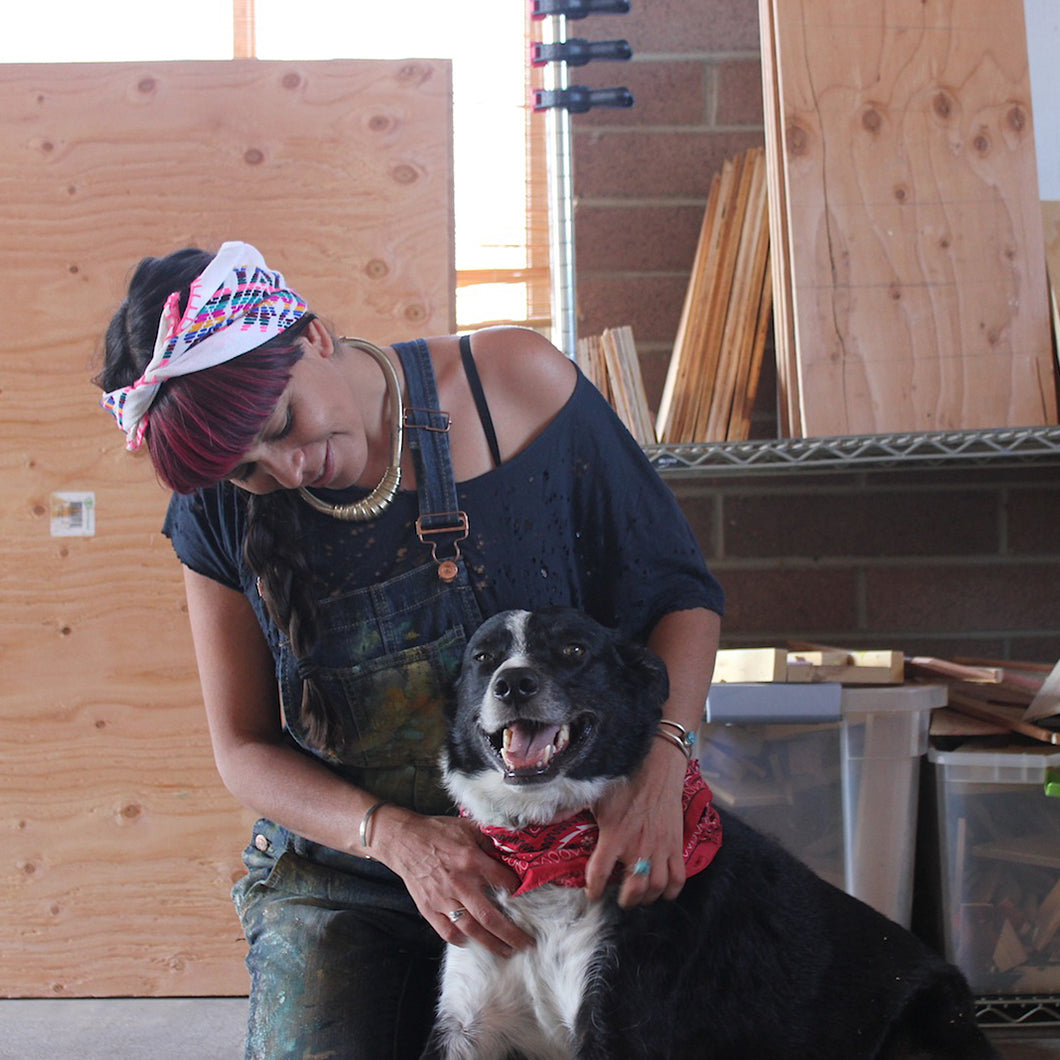 Xihomara and her dog in the studio.