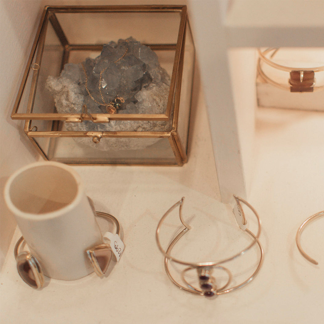 rings and geode in case