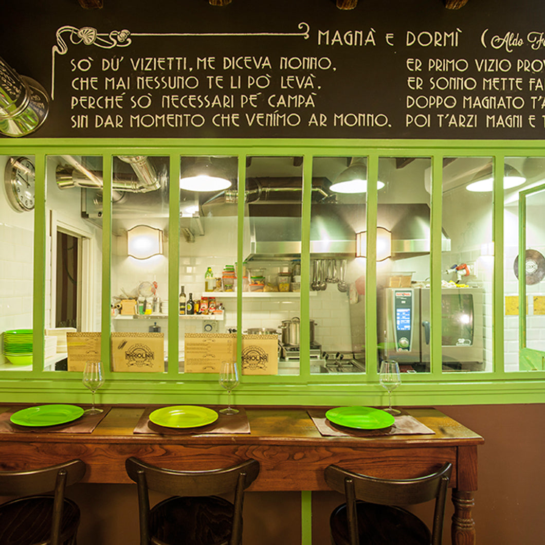 Lime green window panes and plates inside Mariolina.