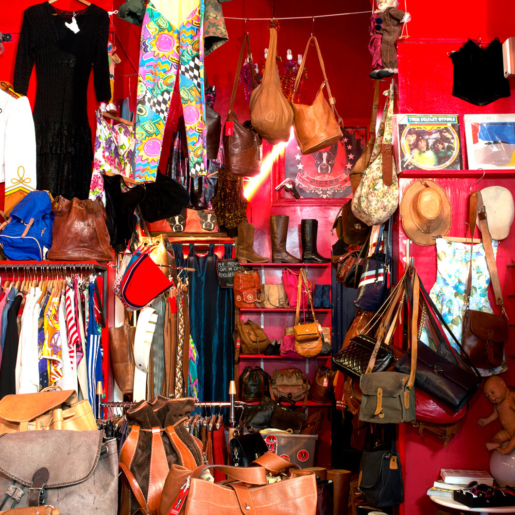 Shoes, clothes, purses, and hats hang all around the interior of Pifebo.