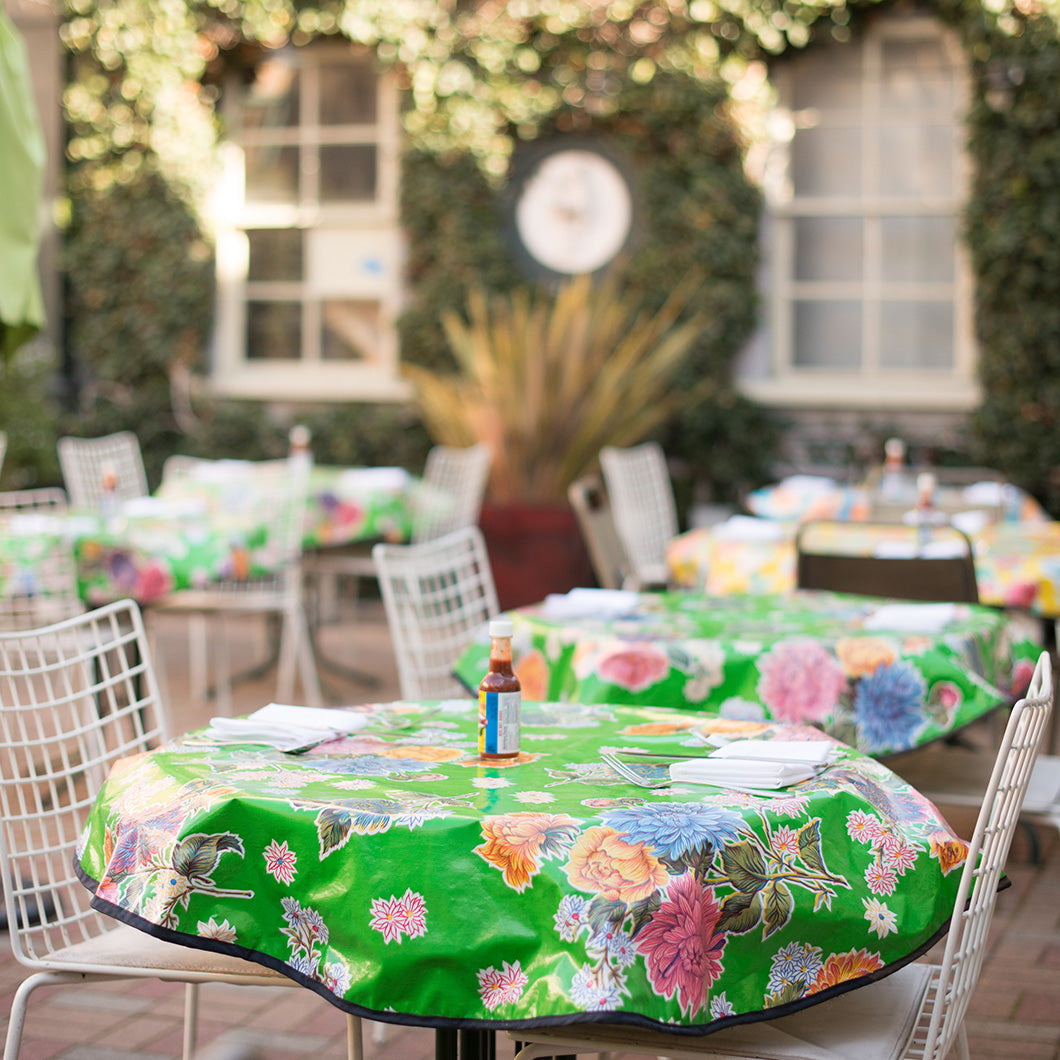 Green floral tablecloth brightens up the outdoor patio of Dona Tomas.
