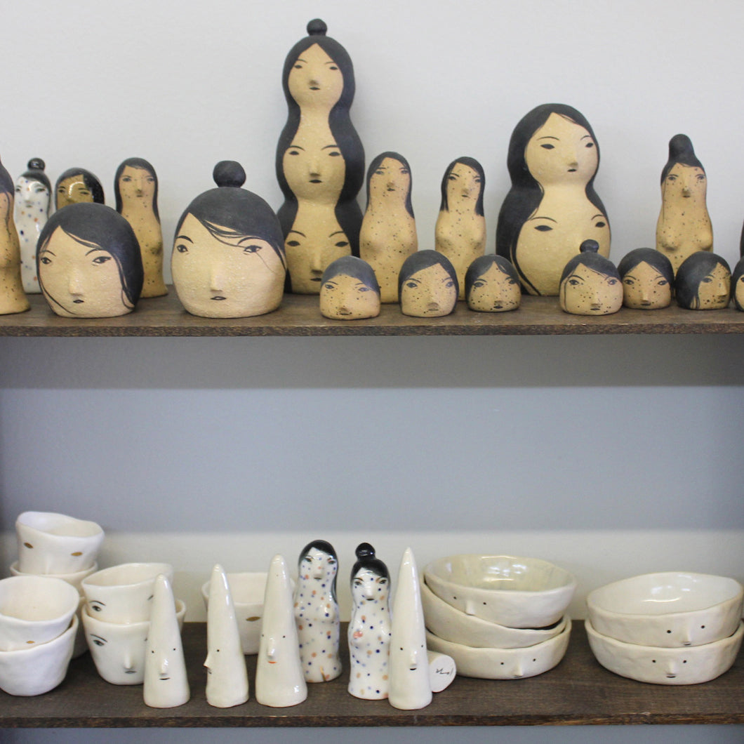 Totem Head Products Shelves