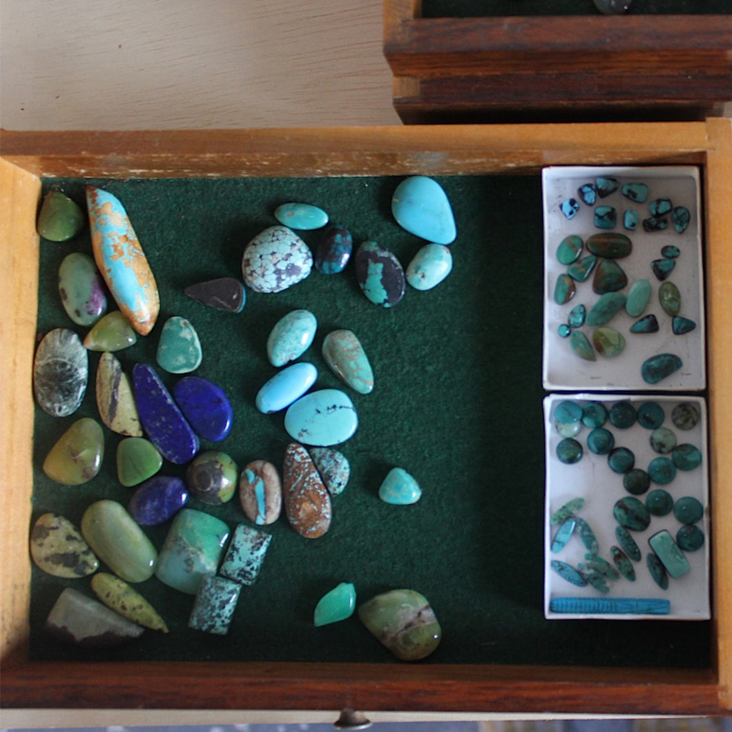 Box of multicolored and different sized stones.