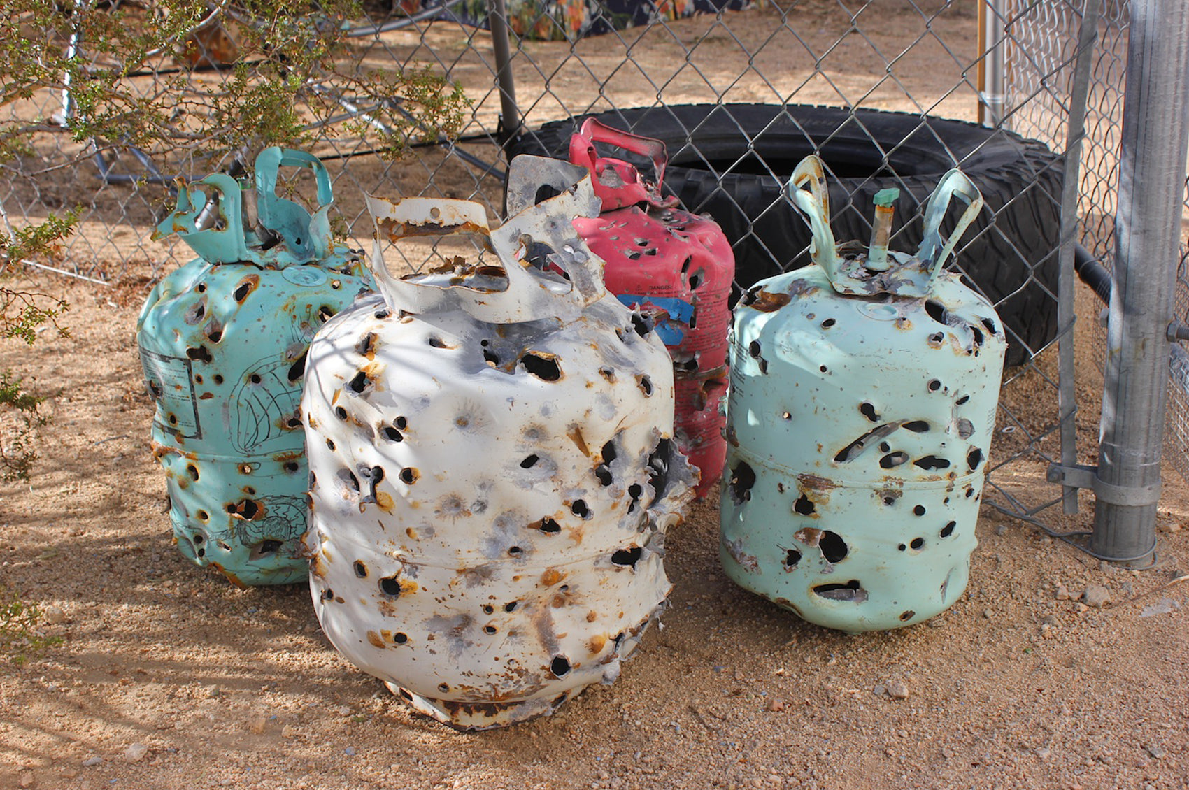 Empty gas canisters with bulletholes.