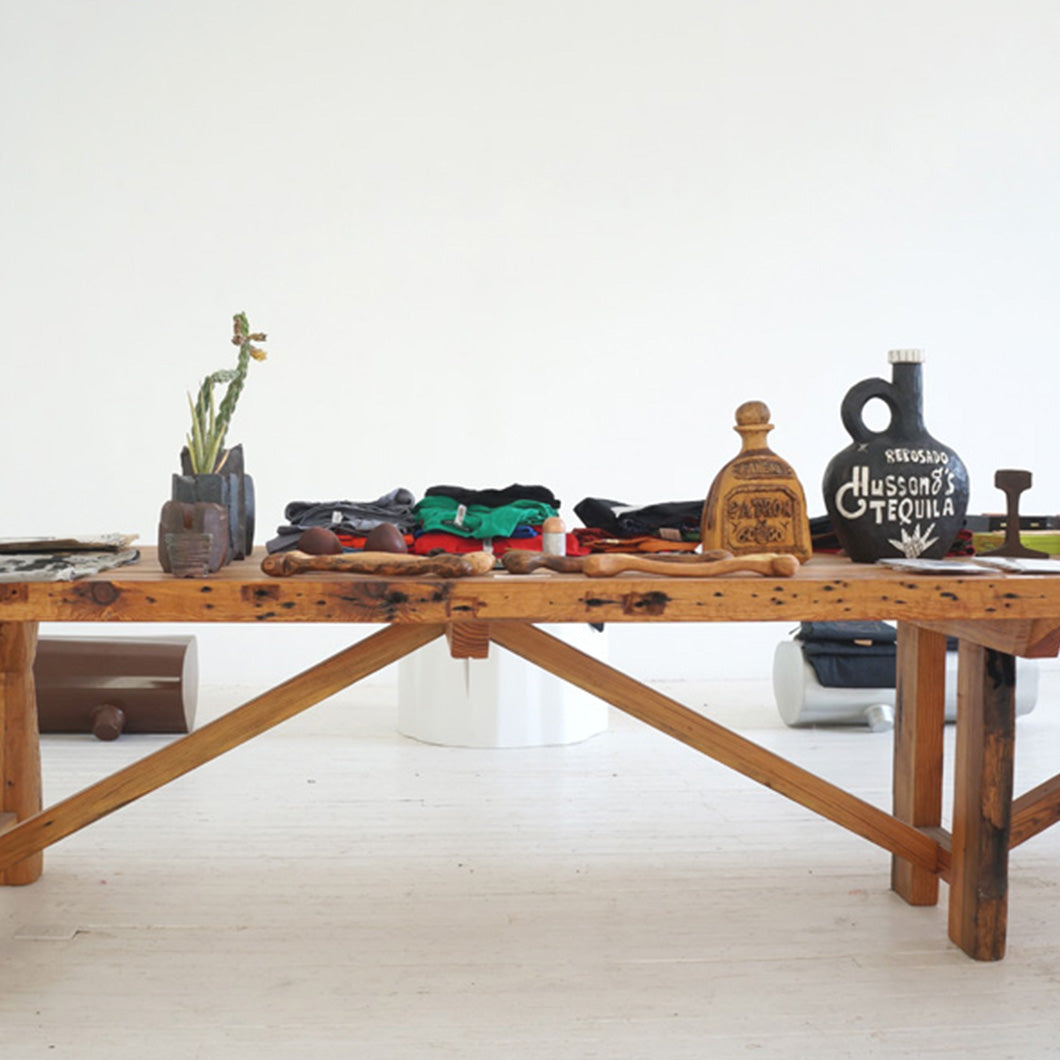 Hand-crafted wooden pieces on a wooden table.