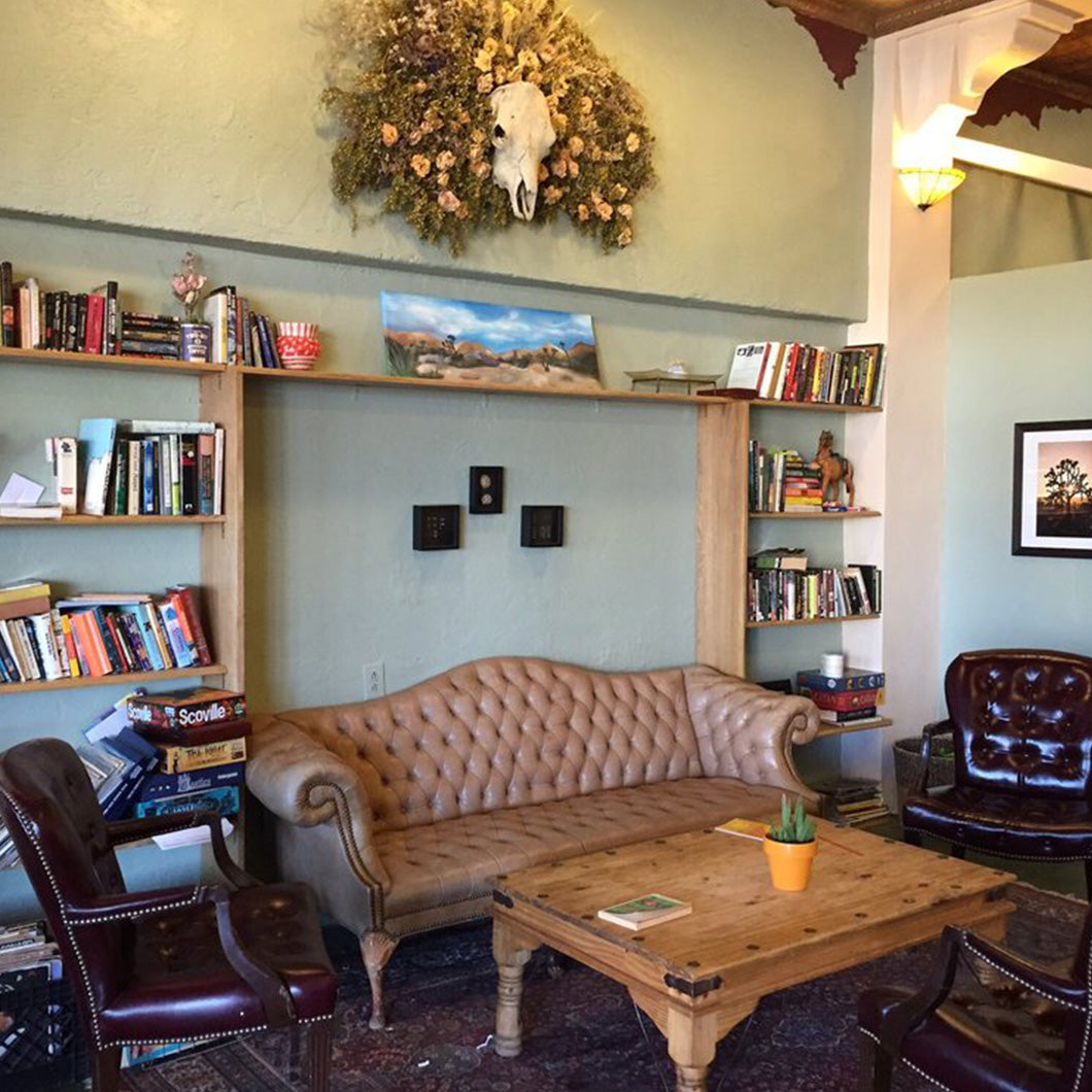 Leather sofas and bookshelf inside Frontier Cafe.