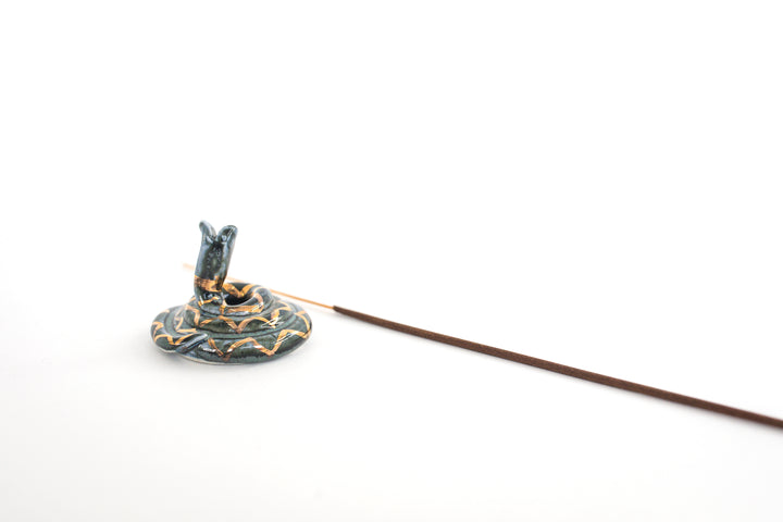 snake incense holder