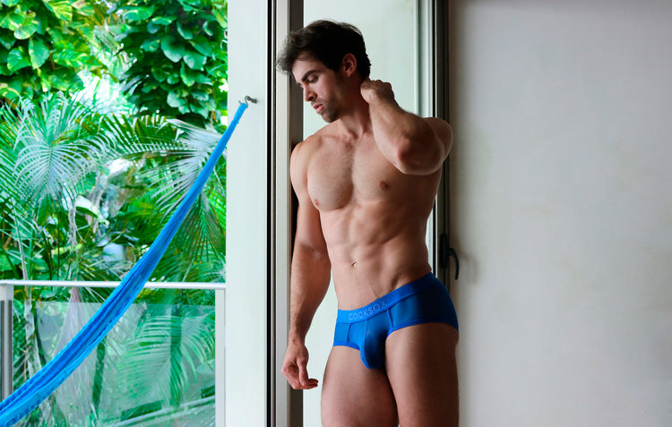 Lifestyle editorial image featuring Cocksox CX76ME Mesh Collection men's underwear sports briefs in Tranquil Blue