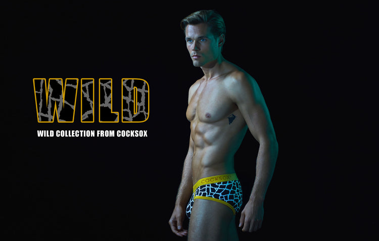 Lifestyle editorial image for the Cocksox Wild Collection underwear range featuring CX76WD sports briefs in Giraffe print