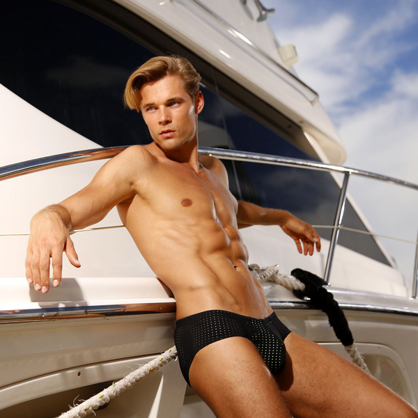 Lifestyle editorial image featuring Cocksox CX79SB swimwear briefs