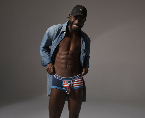 Lifestyle editorial image featuring Cocksox CX68N Americana Collection men's underwear trunks in Patriot Blue