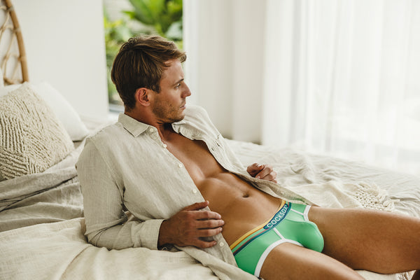 Lifestyle editorial image featuring Cocksox CX76N Florida Collection men's underwear sports briefs in Clearwater green