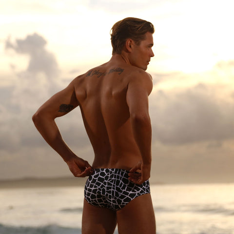 Editorial lifestyle image featuring Cocksox CX79PR Wild Collection Boy-Leg swimwear briefs in Giraffe print