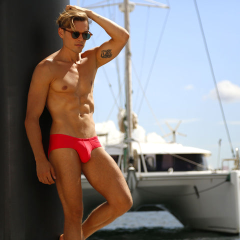 Editorial lifestyle image featuring Cocksox CX79 Boy-Leg swimwear briefs in Watermelon