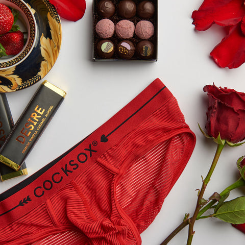 Editorial flatlay image featuring Cocksox CX76SH sheer underwear sports briefs in Cupid Red