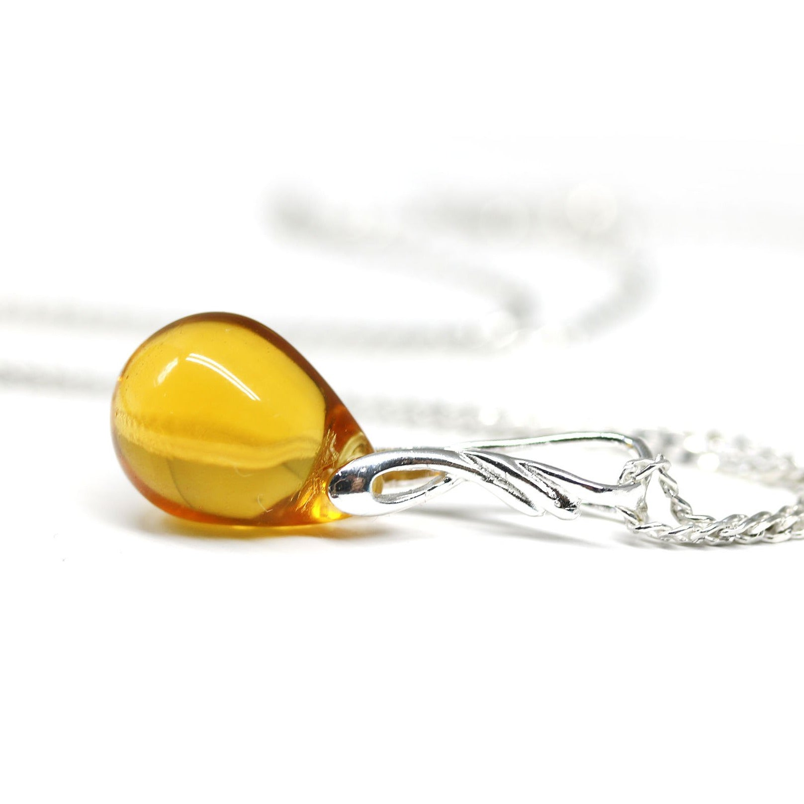 Amber yellow drop glass pendant on sterling silver chain