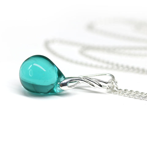 Light teal drop glass pendant on sterling silver chain