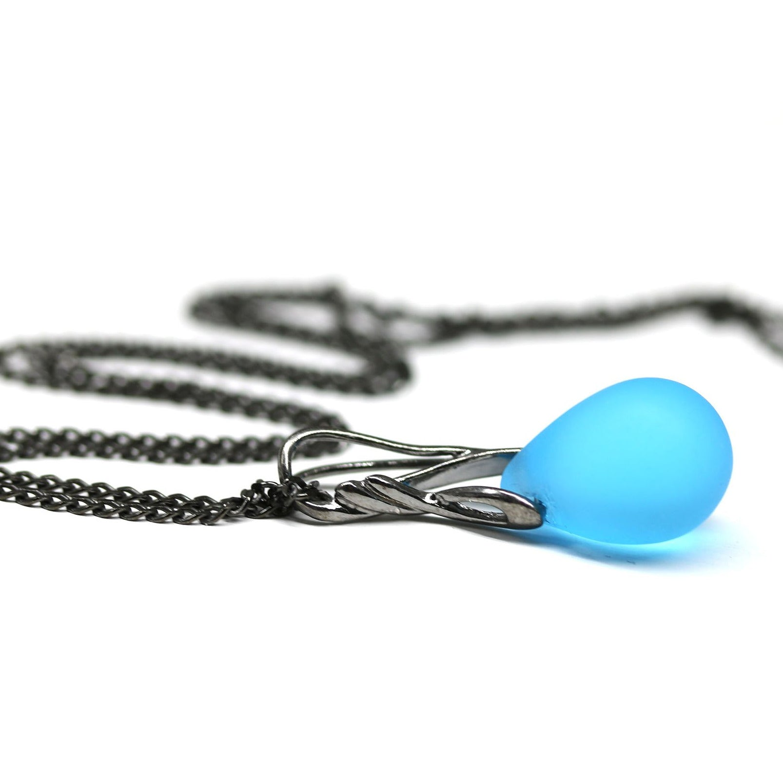 Frosted blue drop glass pendant on black rhodium chain