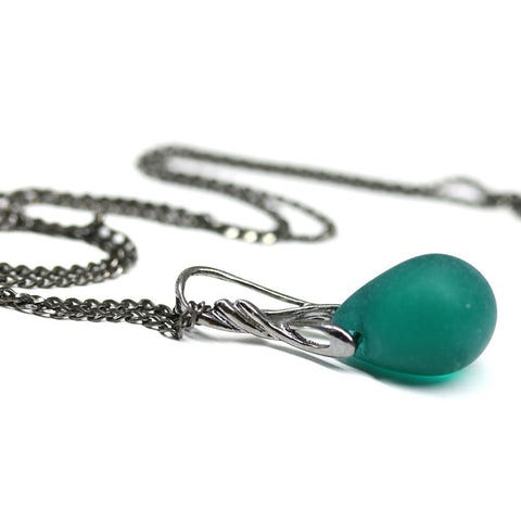 Frosted dark teal green drop glass pendant on black rhodium chain