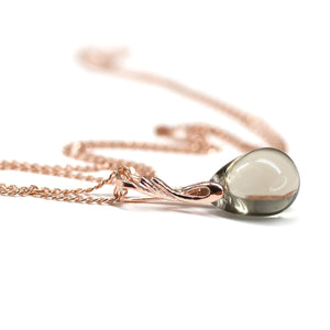 Light gray drop glass pendant on rose gold coated chain
