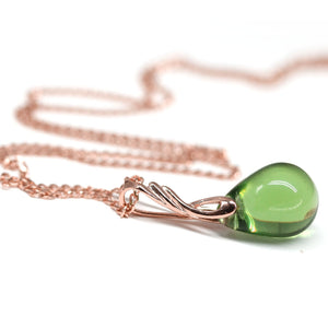 Light olivine green drop glass pendant on rose gold coated chain for women