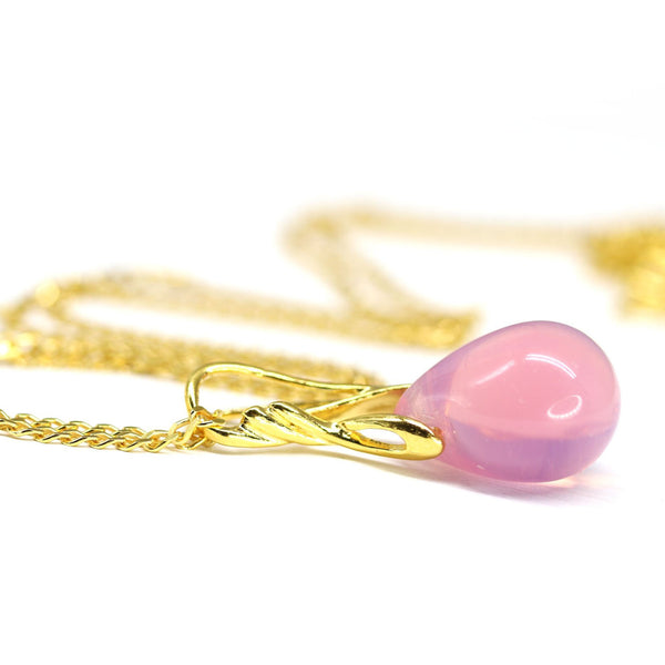 Opal pink drop glass pendant on golden coated chain