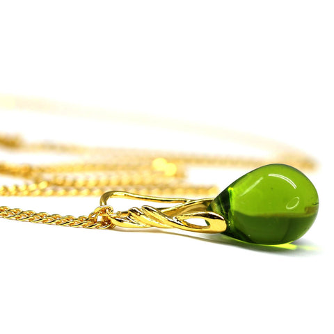 Olive green drop glass pendant on golden coated chain